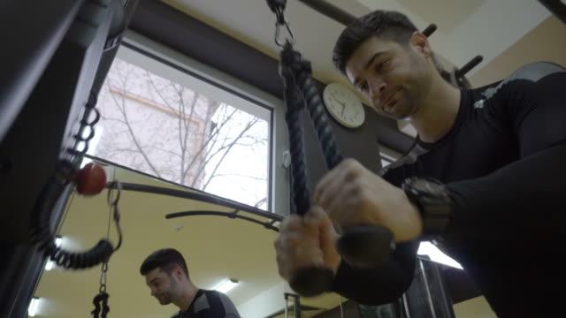 favorite machine to workout on - mascolinità video stock e b–roll