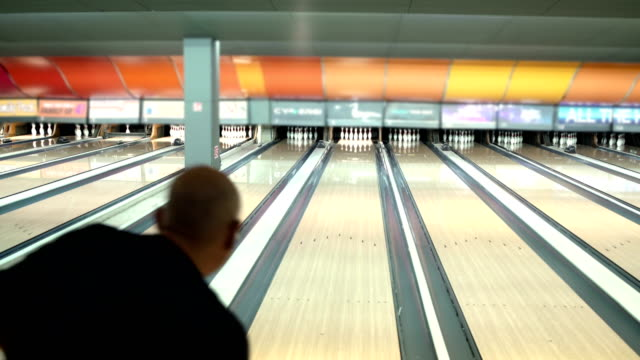 favourite activity. senior men  in the bowling club - bowling alley stock videos & royalty-free footage