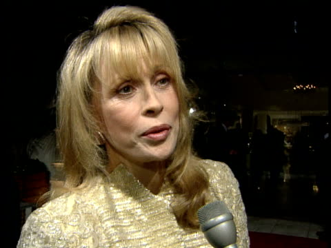 faye dunaway talks to reporter about why people support the event and the fashion on the red carpet - faye dunaway stock videos and b-roll footage