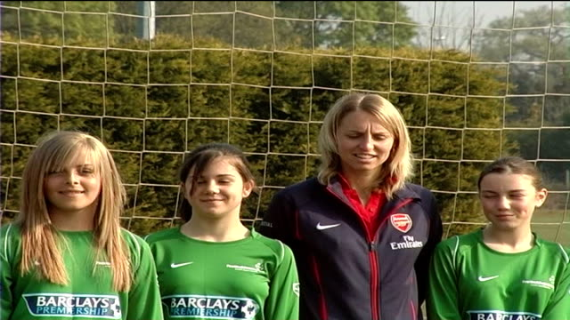 Faye White promotes women's football before UEFA Cup Final ENGLAND Surrey Oakwood School EXT Faye White posing in goal for photocall with female...