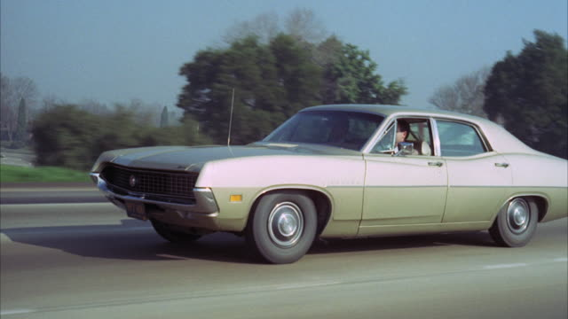 vidéos et rushes de ms ts fbi car running on street / los angeles, california, united states - 1970