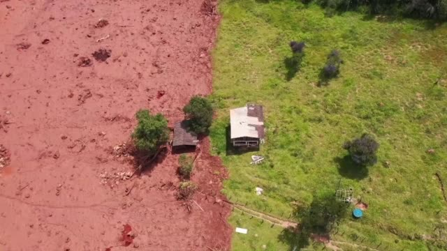 fears of a second dam breach at a brazilian mining complex receded sunday enabling a search to resume for the more than 300 people still missing two... - collapsing stock videos and b-roll footage