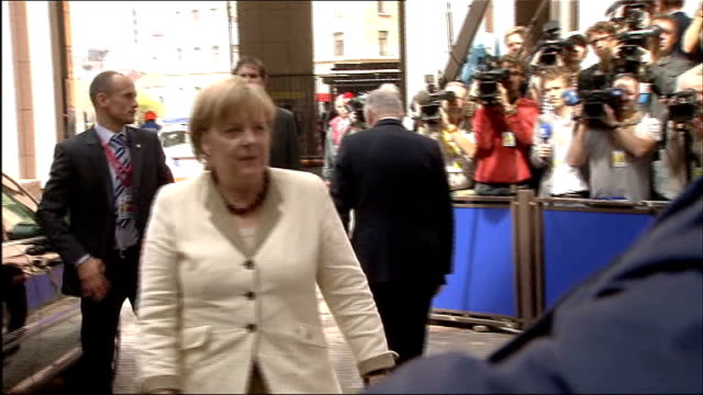 Fears of global financial crisis as world share prices crash LIB / TX Brussels EXT Angela Merkel out of car and looking up at sky as arrives for...