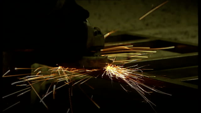 share prices continue to fall t06061109 manchester general and tube engineering int various shots of man sanding metal frame and sparks flying bv... - man and machine stock videos & royalty-free footage