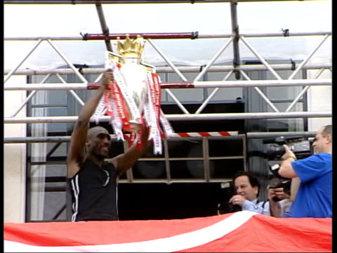 fears over the future of sol campbell file / r16050401 may 2004 london ext sol campbell holding up premiership trophy after arsenal won the... - 2004 stock videos & royalty-free footage
