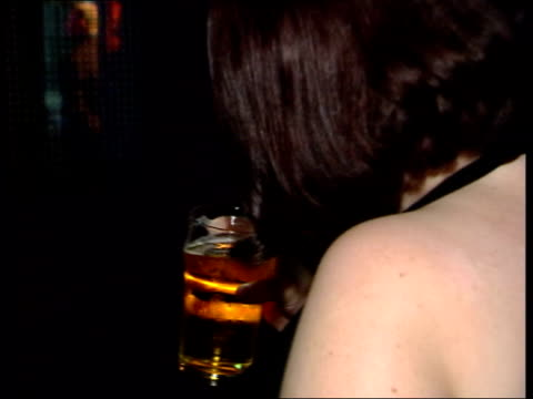 fears over womens alcohol consumption lib woman holding pint of lager pull la cms girls in bar holding drinks la cms drink held - lager stock videos & royalty-free footage