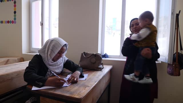 fears schoolgirls will be first in line of fire after us withdrawal from afghanistan; afghanistan: kabul: ext various shots of man and toddler... - women stock videos & royalty-free footage