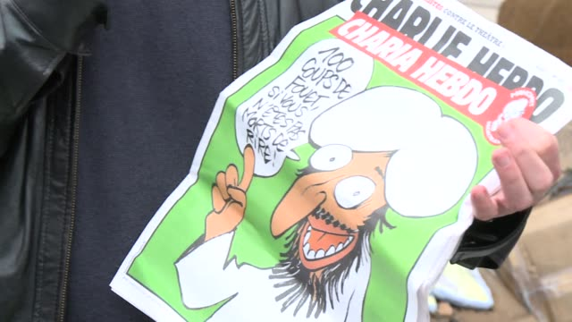vídeos y material grabado en eventos de stock de fears that a wave of anger in the islamic world could spread to europe mount as a french magazine confirms it is planning to publish cartoons... - religión