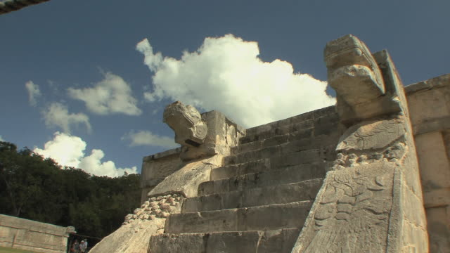 ms feathered serpents heads at platform of the eagles and the jaguars at pre-columbian archaeological site built by maya civilization / chichen itza, yucatan, mexico - chichen itza stock videos and b-roll footage