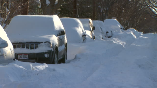 february 11, 2010 cars covered in snow stuck on street after blizzard / washington, d.c., united states - 2010 stock videos & royalty-free footage