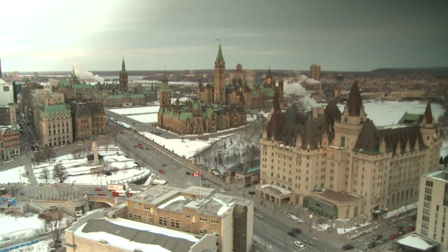 February 14 2009 MONTAGE Downtown Ottawa and Parliament Hill chimneys blowing smoke / Ottawa Ontario Canada