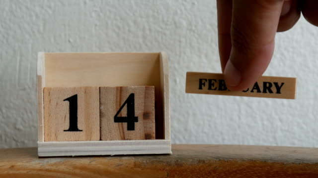 February 14 date on wooden label calendar place   with copy space