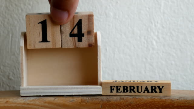 february 14 date on wooden label calendar place   with copy space - valentines background stock videos & royalty-free footage