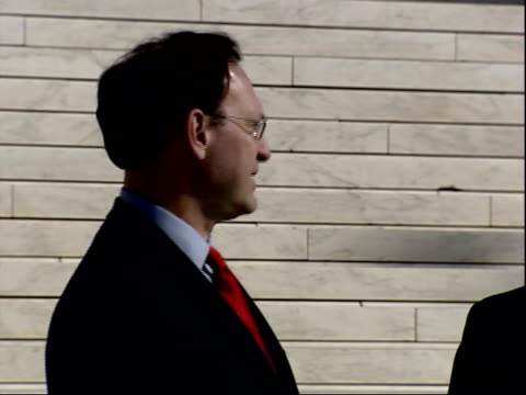 february 16 2006 zi justice alito standing below the steps of the us supreme court building / washington dc united states - samuel alito stock videos & royalty-free footage