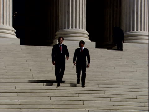 february 16, 2006 justice roberts and justice alito descending the steps of the u.s. supreme court building / washington, d.c., united states - supreme court justice stock videos & royalty-free footage