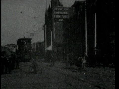 February 17, 1898 WS Double decker electric streetcar going down main thoroughfare of San Diego / San Diego, California, United States
