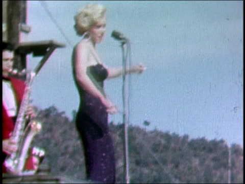 stockvideo's en b-roll-footage met february 18 1954 shaky medium shot marilyn monroe singing and dancing onstage / saxophonist in background / korea - marilyn monroe