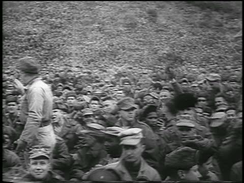 stockvideo's en b-roll-footage met b/w february 18 1954 slight pan huge crowd of soldiers in audience wait for marilyn monroe / korea / newsreel - 1954
