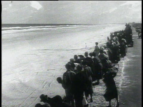 23 February 1933 MONTAGE Campbell races along beach as he sets a new auto speed record / Daytona Beach Florida United States