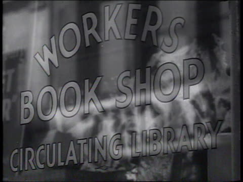 february, 1941 cu storefront window for workers book shop circulating library / new york city, new york, united states - book shop stock videos & royalty-free footage