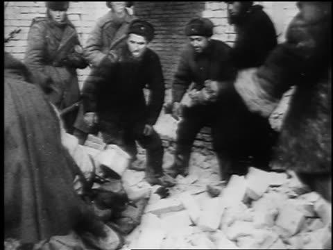 b/w february 1943 soviet soldiers push surrendered german soldier at siege of stalingrad / newsreel - volgograd stock videos & royalty-free footage