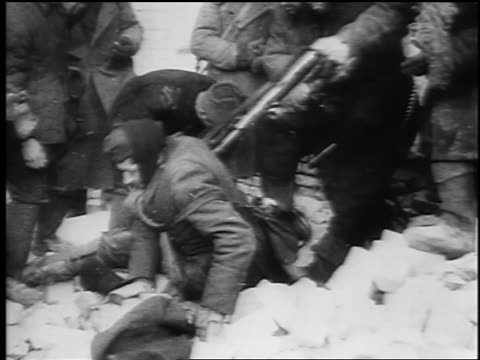 b/w february 1943 soviet soldiers push surrendered german soldier at siege of stalingrad / newsreel - domination stock videos & royalty-free footage