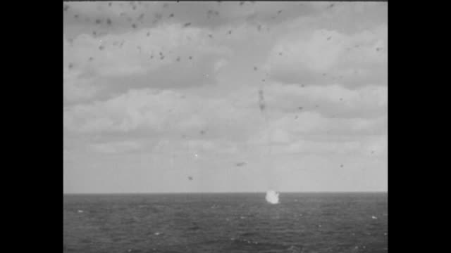 [february 1945] ws uss saratoga at sea with flak all around from battle / japanese plane hits the water sends up a spray of water and smoke / ws... - warship stock videos & royalty-free footage