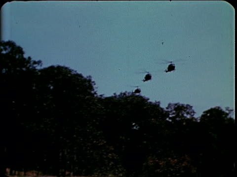 february 1969 ts helicopters approaching and landing with ground forces advancing to meet them / pleiku south vietnam - south vietnam stock videos and b-roll footage