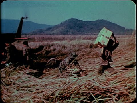 february 1969 soldiers unloading supplies from helicopter / pleiku, south vietnam - south vietnam stock videos & royalty-free footage