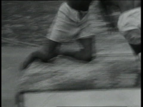 february 2, 1931 montage boys wrestling on greased raft and falling into water / cocolobo cay, florida, united states - 1931 stock videos & royalty-free footage