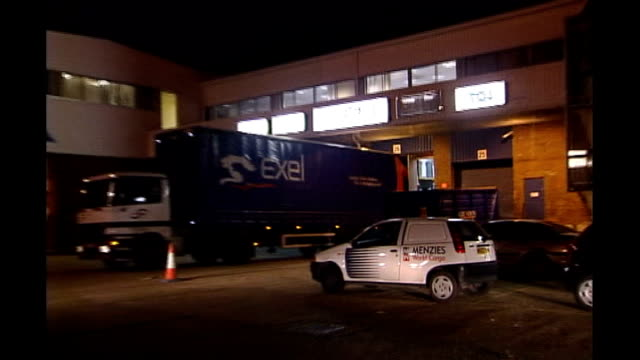 london heathrow airport menzies world cargo vehicle and lorries at worehouse following robbery by armed robbers night ends - thief stock videos & royalty-free footage