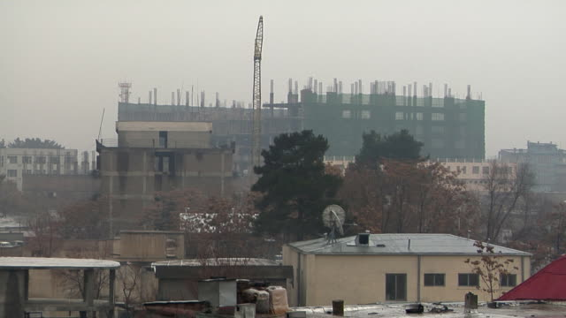february 2009 cityscape with building under construction in background / kabul, afghanistan - rebuilding stock videos & royalty-free footage