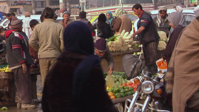 february 2009 ms crowd at vegetable market / kabul afghanistan - kabul stock videos and b-roll footage