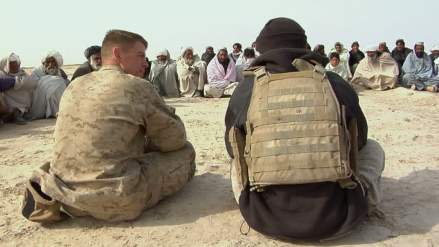 stockvideo's en b-roll-footage met february 2009 ms group of afghani people and soldiers having discussion outdoor / bakwa farah province afghanistan - in kleermakerszit