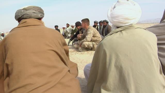 february 2009 ms group of afghani people having discussion outdoor / bakwa farah province afghanistan - korslagda ben bildbanksvideor och videomaterial från bakom kulisserna