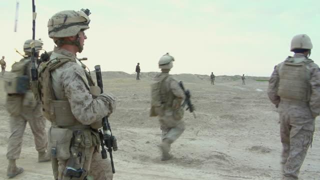 stockvideo's en b-roll-footage met february 2009 ws pan group of soldiers over field / bakwa farah province afghanistan - vertaling