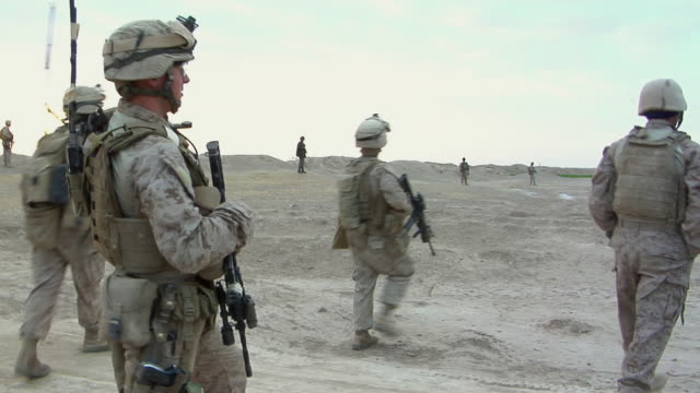 february 2009 ws pan group of soldiers over field / bakwa farah province afghanistan - us marine corps stock videos & royalty-free footage
