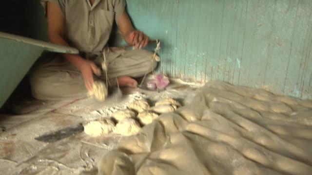 February 2009 MS TU TD Man weighting dough / Kabul Afghanistan