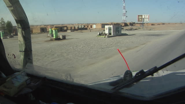 february 2009 military land vehicle on dirt track / bakwa, farah province, afghanistan - military land vehicle stock videos & royalty-free footage