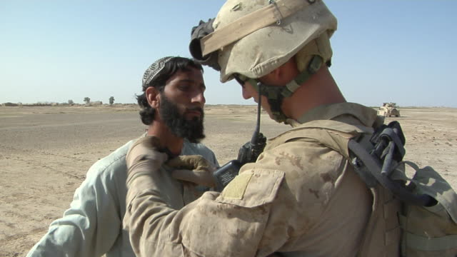 February 2009 MS Soldier examining man / Bakwa Farah Province Afghanistan