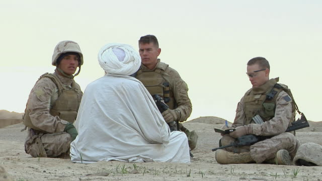 stockvideo's en b-roll-footage met february 2009 ms soldier investigating the local people / bakwa farah province afghanistan - in kleermakerszit