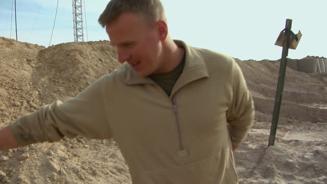 february 2009 ms pan zi soldier searching missile / bakwa farah province afghanistan - 2001年~ アフガニスタン紛争点の映像素材/bロール