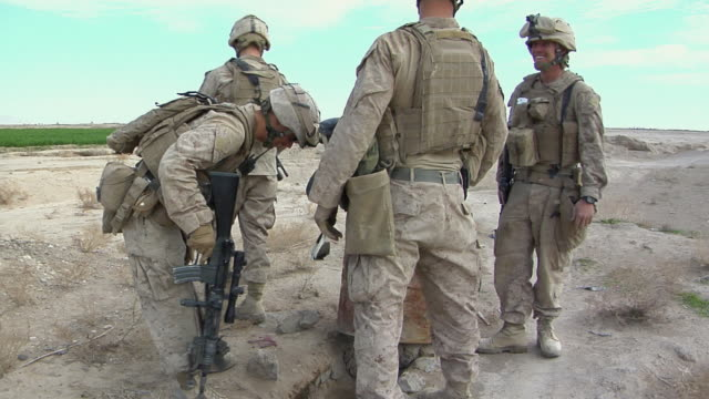 february 2009 ms zi soldiers searching and investigating / bakwa farah province afghanistan - uneven stock videos & royalty-free footage