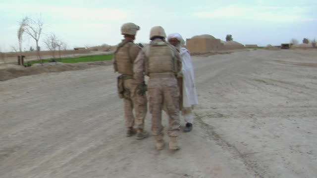 February 2009 MS POV ZI Soldiers talking to Afghani man / Bakwa Farah Province Afghanistan