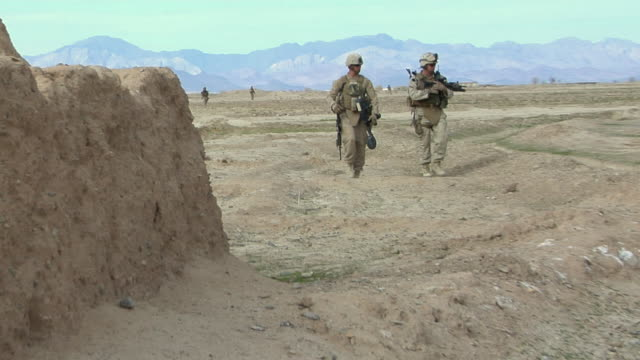 february 2009 ws soldiers walking in desert / bakwa farah province afghanistan - marines stock videos & royalty-free footage