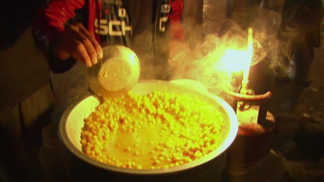 february 2009 street vendor preparing food / kabul, afghanistan - provinz helmand stock-videos und b-roll-filmmaterial