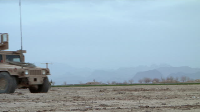 february 2009 ws truck passing through landscape / bakwa farah province afghanistan - hummer stock videos and b-roll footage
