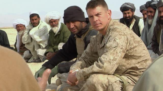 stockvideo's en b-roll-footage met february 2009 ms view of afghani civilians sitting / bakwa farah province afghanistan - vertaling
