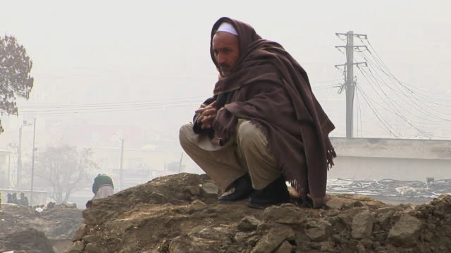 February 2009 WS View of man wrapped in blanket / Kabul Afghanistan