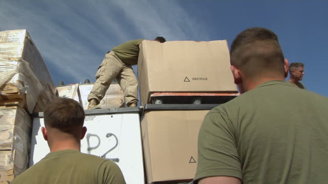 february 2009 ms view of solider distributing mail bakwa farah province afghanistan - operazione enduring freedom video stock e b–roll